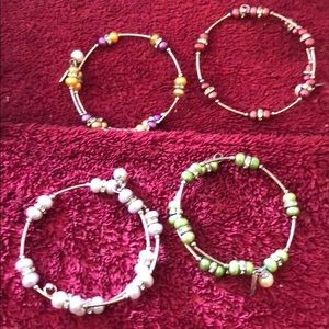 4 bracelets all with freshwater pearls attached